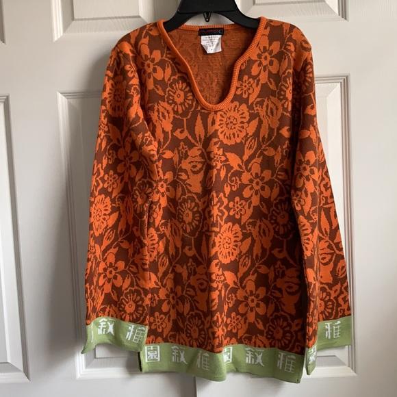 Orange floral tunic with light green hem